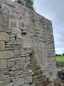 Flaunching of wall head of a 17th Century Chapel - REPAIRS AND REMEDIAL WORK TO HISTORIC WALLS by Mid West Lime